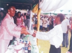Wife of Bayelsa State Governor, Mrs Alanyingi Sylva (left) presenting a gift to a  child at the 2009 Children's Day celebration in Yenagoa, Bayelsa State.