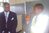 Chairman, Board of  Directors of the Federal Airports Authority of Nigeria (FAAN), Chief Ebitimi Banigo (left) listening to an explanation by the Regional Manager of Port Harcourt International Airport, Omagwa, Mr Uche Nwanguma, when the FAAN board visited the airport, recently.