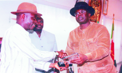 Bayelsa State Governor, Chief Timipre Sylva (right) presenting a souvenir to Senator Biargha Amange, leader of Senate Committee on Petroleum, during the  committees visit to Government House, Yenagoa, recently. Photo: Chris Monyanaga