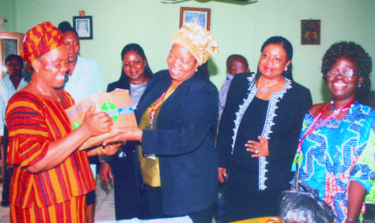 Hon. Shiela Tlow, member of Botswana Parliament (3rd right) presenting a gift to the matron of Cheshire Home, Sister Philomena Iroegbu (left) on behalf of female parliamentarians of the CPA. Closely observing are Hon. Gift Kusi of Ghana (right) and Hon. Maureen Tamuno of Rivers State House of Assembly, last Tuesday.