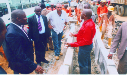 Rivers State Governor, Rt. Hon. Chibuike Amaechi (right) explaining a point during an inspection of projects under construction, recently.