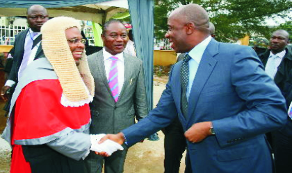 Governor Chibuike Rotimi Amaechi of Rivers State (right) being welcomed by Justice Peter Agumagu, President, Customary Court of Appeal, while Justice Iche Ndu, Chief Judge of Rivers State, watches, at the inauguration and dedication service of the Rivers State Customary Court of Appeal, in Port Harcourt, yesterday.