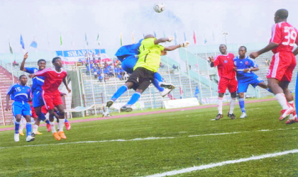 Sharks goalkeeper contesting for ariel ball during a league match at the Liberation Stadium