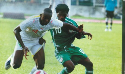 Nigerian youth player (10) in contest with a Malian opponent during a match.