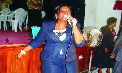 Wife of the Rivers State Governor, Dame Judith Amaechi leading the praise and worship session  during the weekly interdenominational fellowship at Government House, Port Harcourt, after her recovery from  a fracture.
