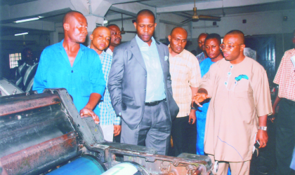 Action Congress (AC) leader in Rivers State, Prince Tonye Princewill (centre) listening as General Manager, Rivers State Newspaper Corporation (RSNC) Mr Celestine Ogolo (right) explains difficulties of printing The Tide newspapers with obsolete machines, as the machine operator, Mr Micheal Menian (left), others watch.
