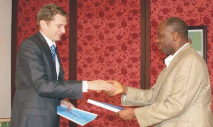 Rivers State Governor, Rt. Hon. Chibuike Rotimi Amaechi (right) in a handshake with Mr Alexander Polyakov, the Russian Ambassador to Nigeria during the signing of Memorandum of Understanding between Rivers State Government and the Russian Government in Port Harcourt, yesterday.