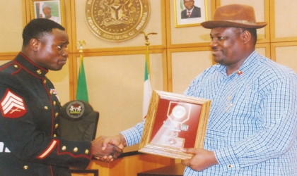 Rivers State Deputy Governor, Engr Tele Ikuru (right) receiving the US Purple Heart Award from Marine Sergeant (Dr)Ledum Ndaaee on behalf of Governor Chibuike Rotimi Amaechi at Government House, Port Harcourt, recently