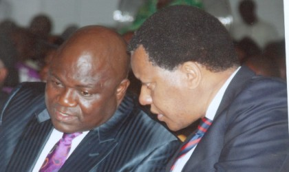 Minister of State for Petroleum, Mr Odein Ajumogobia (SAN) (right) in a chat with the Speaker, Rivers State House of Assembly, Rt Hon Tonye Harry during the accountability forum addresed by Governor Amaechi at Alfred Diete Spiff Civic Centre, Port Harcourt, last Monday. Photo: Chris Monyanaga