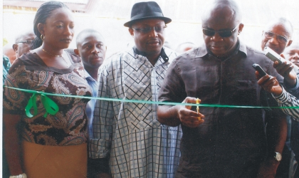 Dr Ibi Erekosima, a Consultant Physician (right) cutting the tape to commission a health facility at the former site of the UPTH , old Port Harcourt Township, assisted by the Rivers State Health Commissioner, Dr Sampson Parker  (centre), recently.