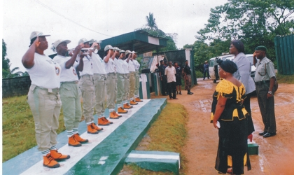 Commissioner for Informamtion, Mrs Ibim Seminatari (right) who represented the state governor, Rt Hon Chibuike Rotimi Amaechi, taking the salute as guest of honour at the NYSC Orintation Camp, Nonwa Gbem, Tai LGA, Rivers State, Wednesday.