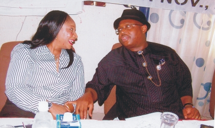 Rivers State Commissioner for Health, Dr Sampson Parker (right) in a chat with the chairman, House Committee on Health, Mrs Irene Inimgba during the official flag off of the new state strategic plan for 2010-2015, yesterday