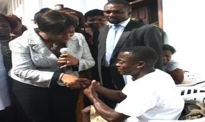 Wife of Rivers State Governor Judith Amaechi exchanging pleasantries with a physically challenged person, during the International Day for People with Disability in Port Harcourt.
