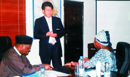 Head of South Korean business delegation to Rivers State, Mr Philip Yun (standing) making a presentation to management of Greater Port Harcourt City Development Authority (GPHCDA). With him are Ufot Ekaette, Minister of Niger Delta Affairs (left) and Administrator of GPHCDA, Dame Aleruchi Cookey-Gam, on Friday.
