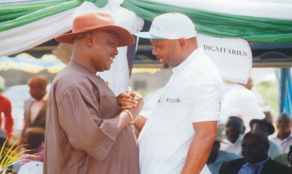 Rivers State Commissioner for Commerce and Industry, Hon. Ogbonna Nwuke (left) in a handshake with his counterpart for Agriculture, Hon. Emmanuel Chindah, during the official launch of FADAMA III project at ADP Demonstration farm, Rumuodomaya, Obio/Akpor LGA, yesterday. Photo: Nwiue Donatus Ken.