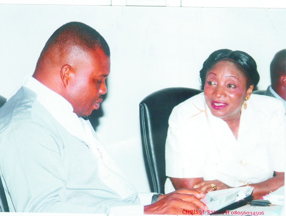 Hon Victor Ihunwo (left) conferring with Hon Irene Inimgba at the Rivers State House of Assembly Complex  Tuesday.