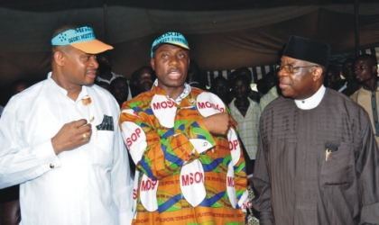 Rivers State Governor, Chibuike Rotimi Amaechi (centre) discussing with Chief Ufot Ekatte Minister of Niger Delta Ministry (right) and Senator Lee Meeba at 2010 Ogoni day celebration at Bori, on Monday.
