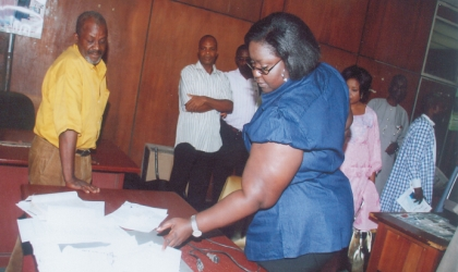 Rivers State Commissioner for Information and Communication, Mrs Ibim Semenitari (standing centre) inspecting news items collections on the News Editor's desk, Mr Thomas Abe, during the commissioner's visit to the Rivers State Rivers State Newspaper Corporation, in Port Harcourt, last Friday. Photo: Chris Monyanaga