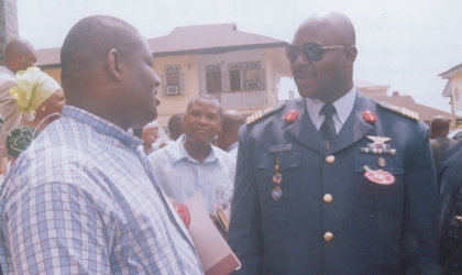 Deputy Governor of Rivers State, Engr Tele Ikuru (left) conferring with Group Captain Charles O. Ohwo, during 2010 Armed Forces Remembrance Day celebration,  at St Cyprians church, Port Harcourt,  last Sunday