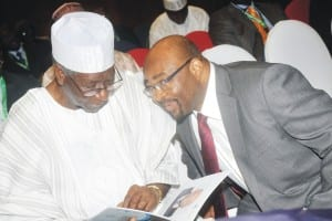 Member, Board of Trustees, Peoples Democratic Party, Chief Tony Anenih (left), going through a programme with the Permanent Representative, International Maritime Organisation, Mr William Azuh, at the 2nd Ministerial Conference on Port control and  10th anniversary celebration of the Abuja MoU, in Abuja,  yesterday.