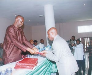 Secretary to Rivers State Government, Hon Magnus Abe (left) presenting the Best Information Officer of the Year Award to Mr Owupele Benibo, during the passing-out ceremony of ICT trained information officers of the Ministry of Information ,yesterday.                                                                                                    Photo: Chris Monyanaga