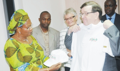 Minister of Information and Communications, Prof. Dora Akunyili (left), presenting Nigerian Re-branding sourvenirs to the Finish Minister of Foreign Trade and Development, Mr Paavo Vayrynen at a bilateral meeting in Abuja, Monday.