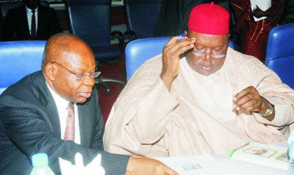 INEC Chairman, Prof. Maurice Iwu (left), with former Senate President, Chief Anyim Pius Anyim going through documents during INEC National Conference for stakeholders in  Electoral Process in Abuja, last Wednesday.