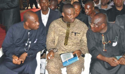Rivers State Governor, Rt. Hon Chibuike Rotimi Amaechi (left) conferring with his Deputy, Engr. Tele Ikuru (centre) and Chief A. J. Turner at the burial  of late Hon. Moses Elemchi Ahubele, Rivers State Commissioner for Employment Generation and Empowerment,  at Abarikpo, Ahoada-East Local Government Area, yesterday.