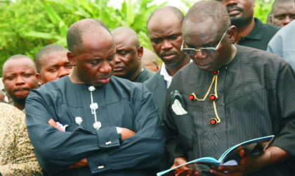 Representative of Nigeria's Acting President, Chief J.Turner (right) and Rivers State Governor, Rt Hon Chibuike Rotimi Amaechi, perusing a document, at the funeral service in honour of late Rivers State Commissioner for Employment Generation and Empowerment, Hon Moses Ahubele, at St Barnabas Anglican Church, Abarikpo, Rivers State, last Saturday