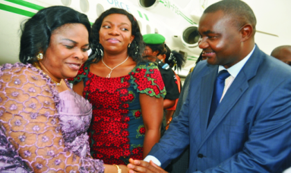 Secretary to Rivers State Government, Hon Magnus Abe (right) welcoming wife of the Acting President, Dame Patience Jonathan.  With them, is wife  of the Rivers State Deputy Governor, Dr. Mina Ikuru, at the Port Harcourt International Airport, Omagwa, yesterday. Photo: NAN