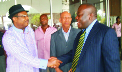 Commissioner for Health, Dr Sampson Parker (left) in a handshake with the General Manager, East, Skye Bank PLC, Mr Chike Meneh, while the Permanent Secretary Ministry of Health, Dr Anthony Nwiado  (2nd right) watches,  during the bank's presentation of insecticide treated net, at the ministry, yesterday.
