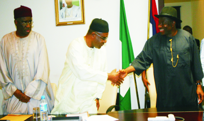 Acting President, Goodluck Jonathan (right), in a handshake with PDP National Chairman, Prince Vincent Ogbulafor  while  the Deputy National Chairman, Adamu Bello watches, at a meeting with the party's Executives in Abuja, yesterday.Photo: NAN
