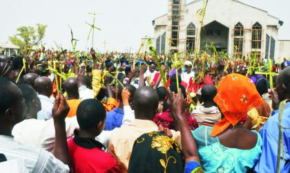 Catholic faithfuls raising their palm branches for blessing at St. Peter and Paul Parish, Nyanya, Abuja to mark 2010 Palm Sunday, yesterday