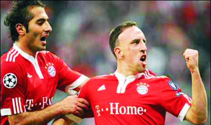 Bayern's Frank Ribery (right) after pulling the Germans level last night