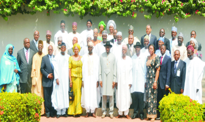 Acting President Goodluck Jonathan, poses with the new ministers after their oath of office in Abuja, yesterday. Photo: NAN