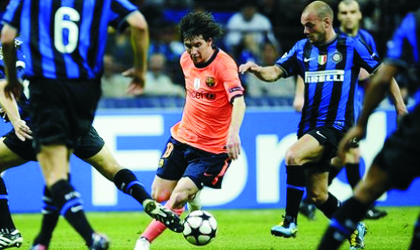Barca's Lionel Messi (middle) being denied space by Inter players yesterday at the San Siro
