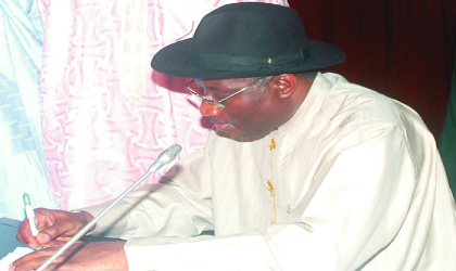 Acting President, Dr Goodluck Jonathan, signing the 2010 budget in Abuja on Thursday