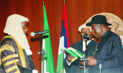 Acting President Goodluck Jonathan (right), taking his oath of office as the President of Nigeria before Chief Justice of the Federation,Justice Aloysius Katsina-Alu in Abuja, on Thursday.