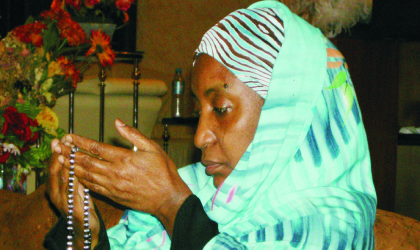 Former First Lady, Turai Yar'adua praying for the repose of her late husband, President Umaru Yar'Adua's soul at the State House Abuja, on Thursday.
