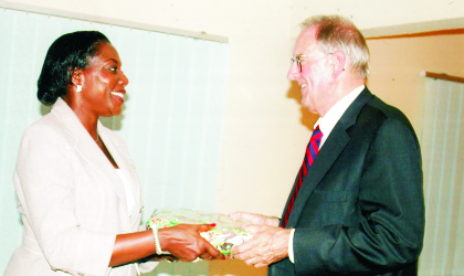 Dame Aleruchi Cookey-Gam, Administrator, Greater Port Harcourt Authority Board  (left) presenting a souvenir to Dr Jonathan Fanton, the immediate past president, MacArthur Foundation, during an official commissioning of its country office  in Port Harcourt, recently. Photo: Chris Monyanaga