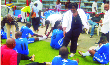 Rivers State Commissioner for Information and Communications , Mrs Ibim Semenatari congratulating players of the Ministry's team, The Mighty Sparrows after their first round victory over Ministry of Finance