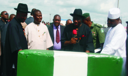 President Goodluck Jonathan (centre) supported by the Speaker, House of Representatives, Hon Demji Bankole (right), Rivers State Governor, Rt Hon Chibuike Rotimi Amaechi  (left) during the commissioning of Eleme junction flyover , Port Harcourt, last Friday. Photo: Chris Monyenaga