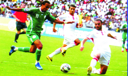 Super Eagles flying attacker, Osaze Odemwingie taking on an opponent, during the world Cup qualifier