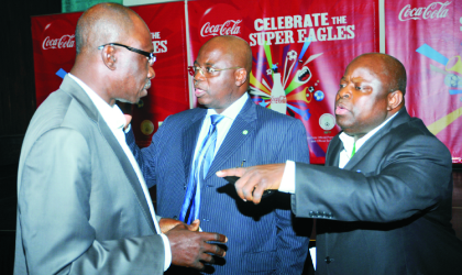 L-R: Director-General, National Sports Commission, Patrick Ekeji, President, Nigeria Football Federation, Sani Lulu and Secretary-General, Bolaji Ojooba, at the send forth dinner for the Super Eagles in Abuja on Friday.