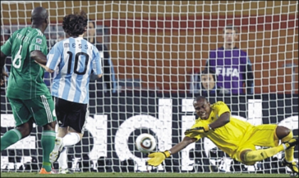 Super Eagles' Goal Keeper, Enyeama, trying to save the ball from entering the net, during the match with Argentina, yesterday