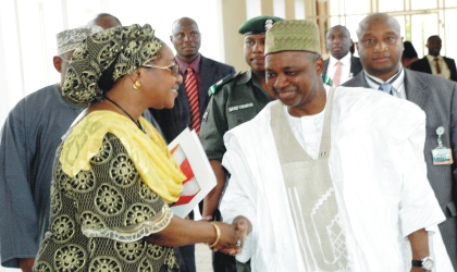 Vice President Namadi Sambo (right) in a handshake with Chairman, Economic and Financial Crimes Commission (EFCC), Mrs Farida Waziri after a meeting at the Presidential Villa in Abuja, yesterday.