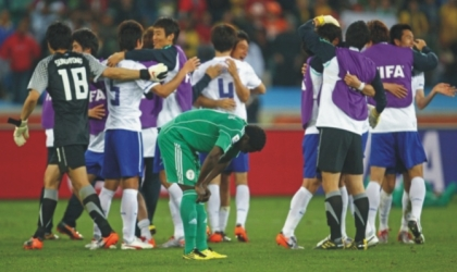 Super Eagles, Obafemi Martins bows in grief as South Korea celebrate , yesterday after their 2-2 draw in Group B
