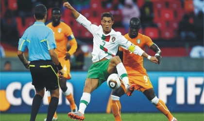 Ronaldo (7) being matched by Ivorian players, yesterday