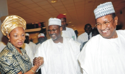 Independent National Electoral Commission (INEC), Commissioner, Mrs Gladys Nwafor (left) congratulating Prof Attahiru Jega, Chairman, INEC (middle), after his screening by the Senate in Abuja on Wednesday. With them is Special Adviser to the President on National  Assembly  Matters, Sen.Mohammed Abba Aji.