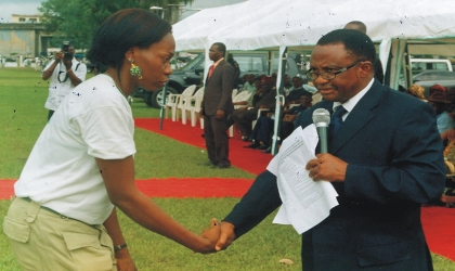 Assistant Director, Central Bank of Nigeria, Rivers State, Barr Ekwebelem Jude (right) congratulating Okereke Prince Adaku, winner of CBN's Corpers Award, during the passing out ceremony of Batch B, 2009 National Youith Service Corps (NYSC) members at Isaac Boro Park, Port Harcourt, last Thursday.Photo: Egberi A. Sampson